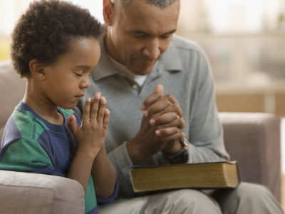dad and son pray slide_405696_5101570_free